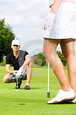 Free Young Sportive Couple Playing Golf On A Course Royalty Free Stock Photos - 31409018
