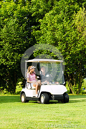 Free Young Sportive Couple With Golf Cart On A Course Royalty Free Stock Image - 26166826