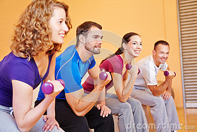 Young sports group with dumbbells