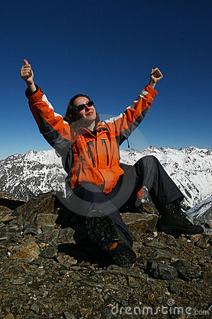 Young sportswomen glad because of mountaineering