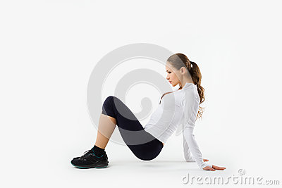 Young sporty girl does gymnastic exercises isolated