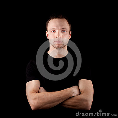Young sporty man in black t-shirt on black