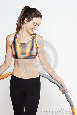 Young sporty woman exercising with a hula hoop Stock Photo