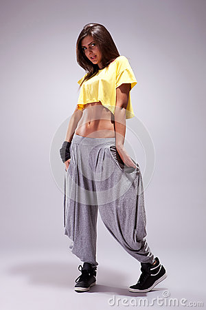 Young sporty woman in a shy pose