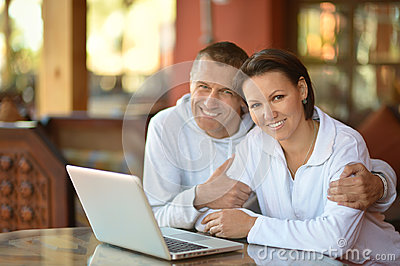Young spouse with laptop Stock Photo
