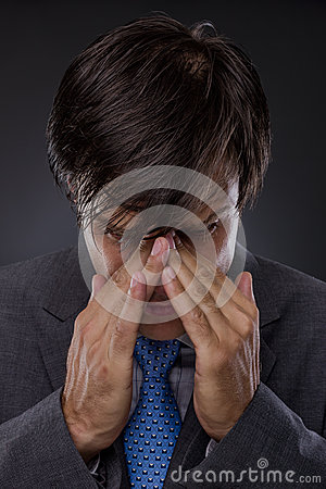Young stressed and tired businessman