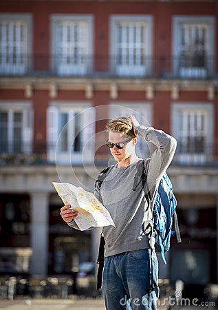 Free Young Student Backpacker Tourist Looking City Map Lost And Confused In Travel Destination Royalty Free Stock Photos - 49677248