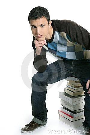 Young student boy sitting over stack books