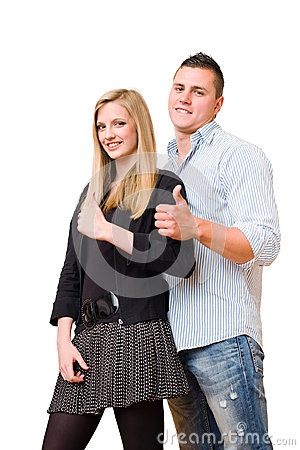 Young student couple showing big thumbs up.