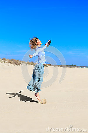 Young student girl is jumping up in the air