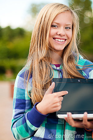 Young student girl with laptop