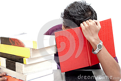 Young Student Hiding His Face with Book