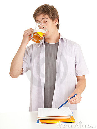 Young student with mug of beer