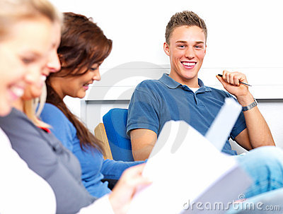 Young student smiling happily in classroom