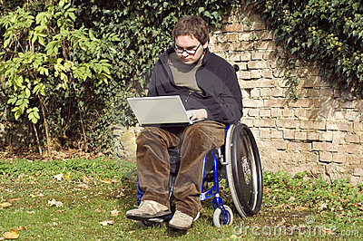 Young student on a wheelchair at the park