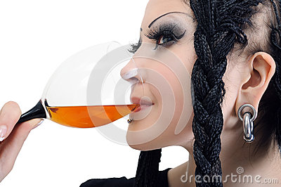 Young stylish woman with dreadlocks, drinking wine