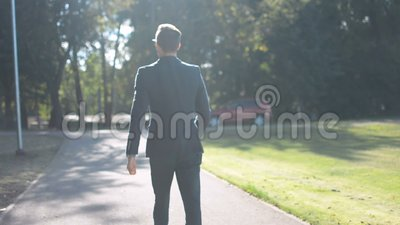 Young Businessman Walking Forward In A Hurry To Job Interview Or Meeting Back To Camera Outdoors Lifestyle