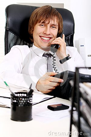 Young And Successful Businessman Talking By Phone Royalty Free Stock Photo - Image: 22856315