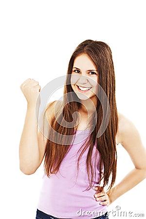 Young successful woman in joyful celebration.