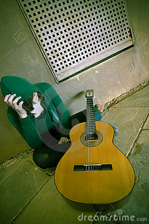 Free Young Suffering Guitar Performer Stock Photo - 5063310