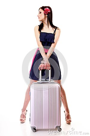 Young summer girl with travel suitcase on white