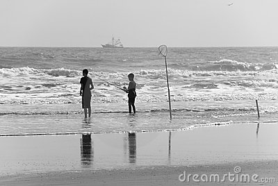 Young surf fishers