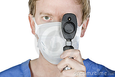 Young Surgeon with Mask Holding Light upto his Eye