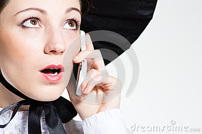 Young surprised woman with mobile phone