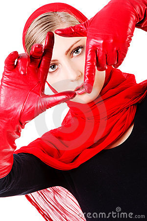 Young sweet carefree girl in red gloves