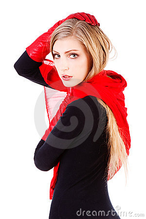 Young sweet carefree girl in red scarf