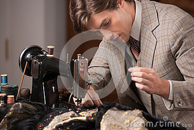 Young tailor at work.