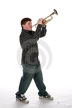 Young  teen boy playing trumpet