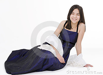 Young teen girl in elegant, dark blue dress gown