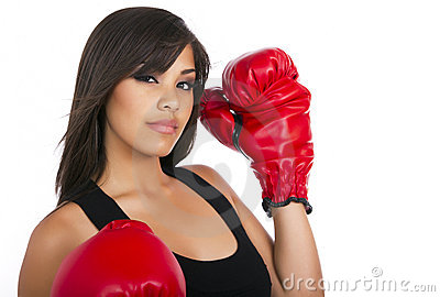 Young teen girl wearing boxing gloves