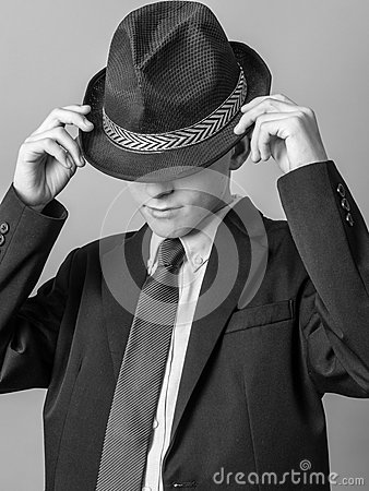 Young Teen posing in Hat, Suit and Tie
