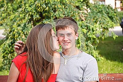 Young teen woman kissing boyfriend