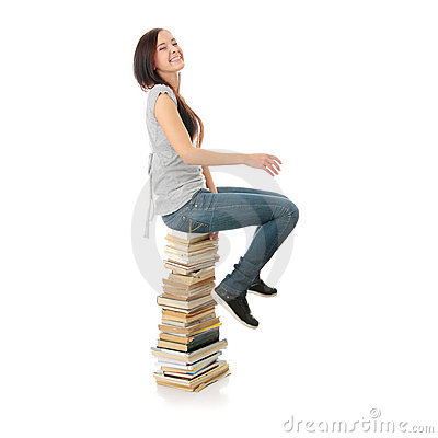 Young teen woman sitting on books