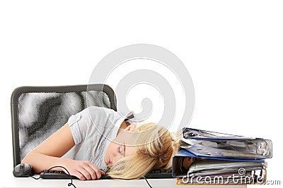 Young teen woman sleeping on keyboard