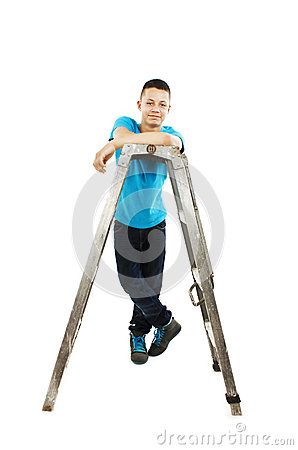 Young teenage boy leaning on a stepladder