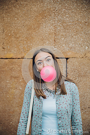 Free Young Teenage Girl Blowing Pink Bubble Gum Royalty Free Stock Photos - 54459768