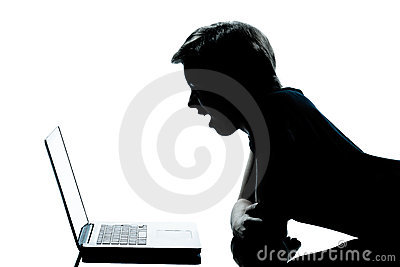 Young teenager boy or girl silhouette computer lap