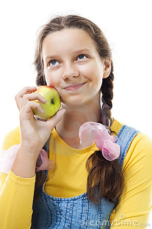 Young teenager girl with apple standing