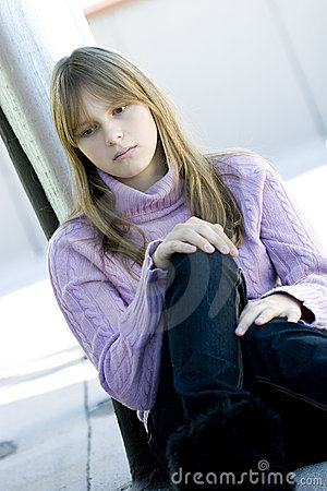 Young teenager girl with sad depressed expression