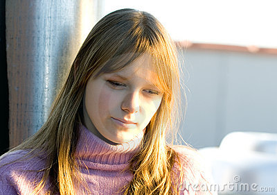 Young teenager girl with thinking expression