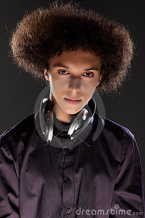 Young teenager man music DJ with afro hairstyle