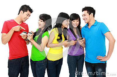 Young teenager using handphone
