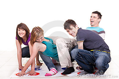Young teenagers playing twister