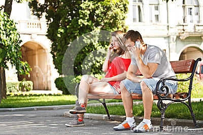 Young teens talking on the mobile phone