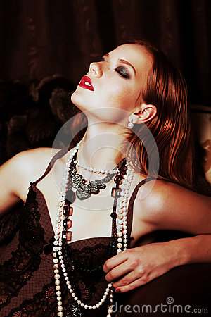 Young tempting red hair woman with sensual emotion