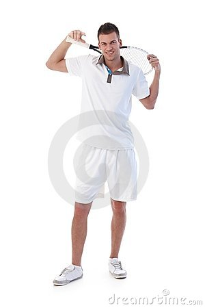 Young tennis player posing with tennis racket